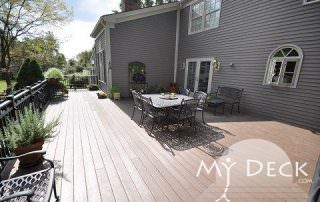 grey house with deck