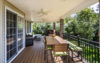 covered deck with outdoor dining area
