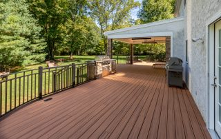 covered deck area with bbq & grill
