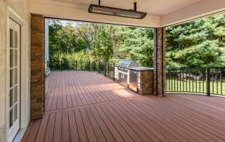 covered deck area with bbq & heater