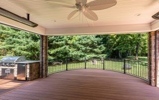 covered deck area with ceiling fan